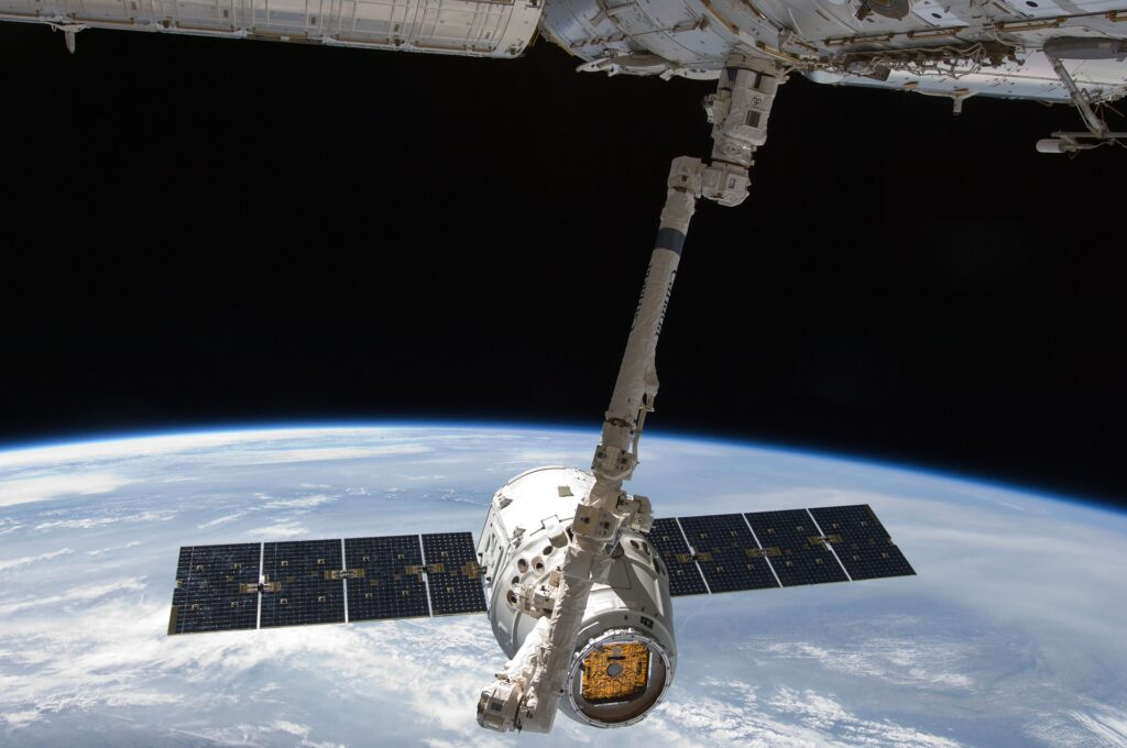 Dragon cargo capsule arriving at the International Space Station. Image by SpaceX-Imagery from Pixabay
